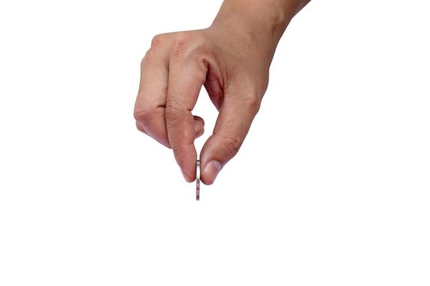 コインを持っている手と白い背景の上のコイン保持ジェスチャー
