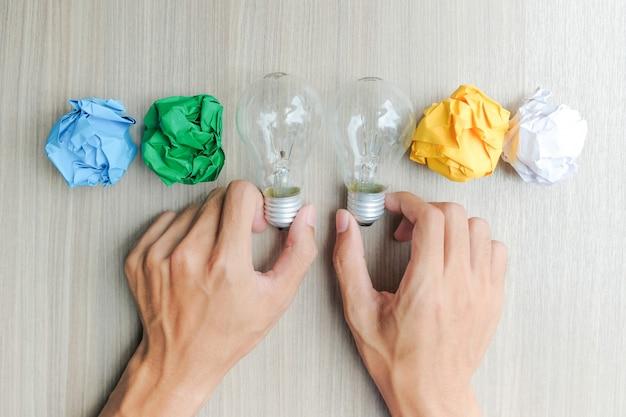 Hand holding couple light bulb or lamp