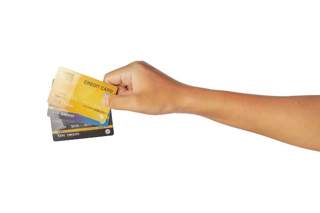 白い背景で隔離のクレジットカードを持っている手。クリッピングパス。