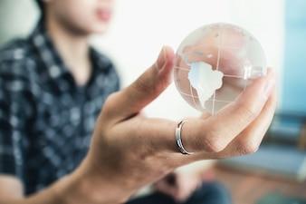 Hand holding crystal world. business symbol