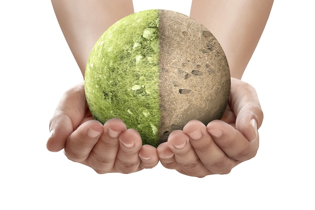 Hand holding the difference from drought ground and fertile soil on the field on the earth