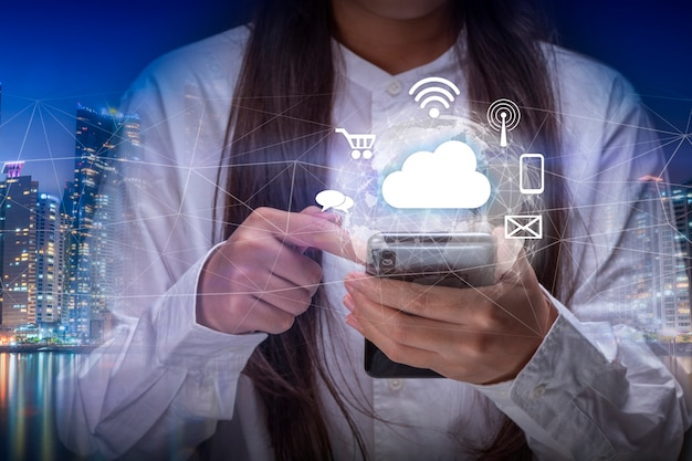 Hand holding a digital world with smart services icons and internet of things technology concept
