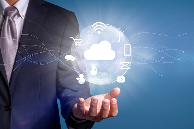 Hand holding a digital world with smart services icons and internet of things wireless networks