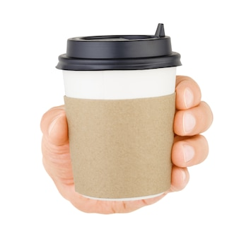 Hand holding disposable paper cup for take out beverages isolated on white background