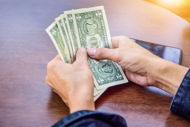 Hand holding dollar for shopping,money banknote saving and investment concept