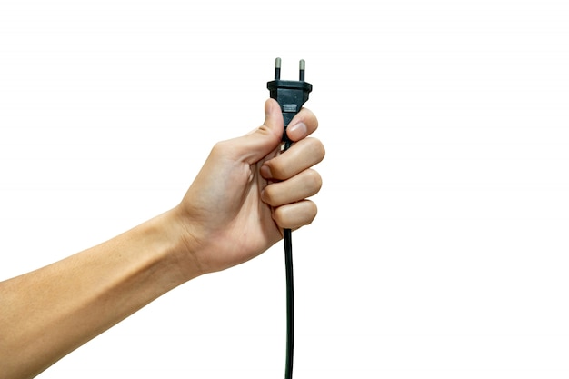 Hand holding electric plug isolated from a white background.