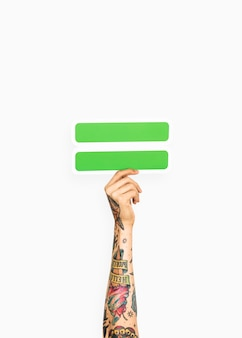 Hand holding equal symbol
