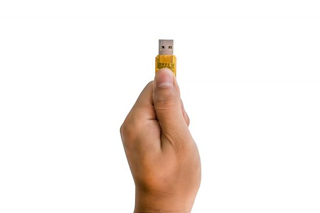 Hand holding flash drive