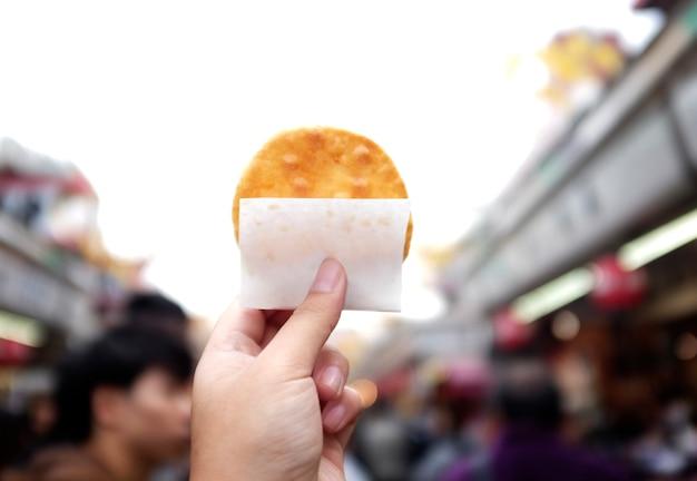 Hand holding food japanese cracker