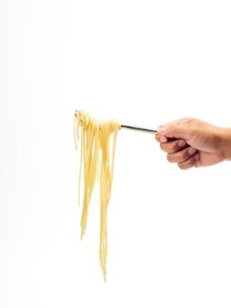 Hand holding fork handle roll spaghetti line