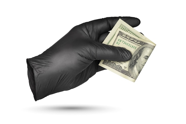 Hand holding or give hundred dollar bill in black nitrile protective glove isolated on white surface.