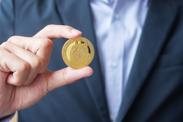 Hand holding gold dogecoin