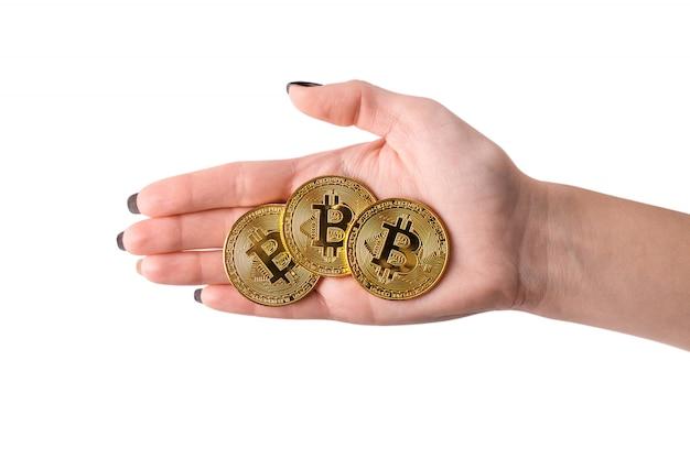 Hand holding golden bitcoin