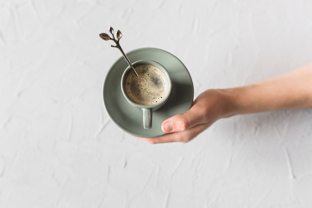 Hand holding green coffee set