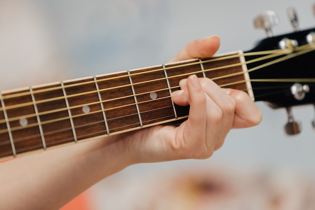Hand holding a guitar