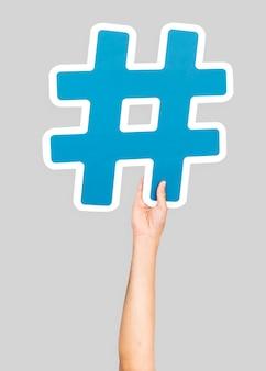 Hand holding hashtag symbol