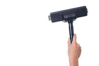 Hand holding head of sweeper cleaning device of vacuum cleaner