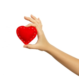 Hand holding a heart isolated