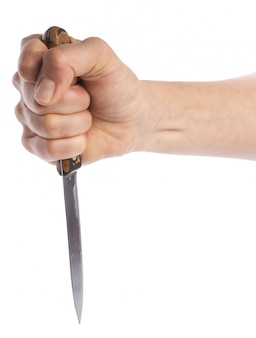Hand holding a knife isolated on white