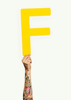 Hand holding the letter f