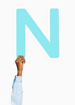 Hand holding letter n sign
