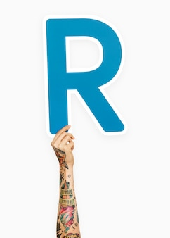 Hand holding the letter r