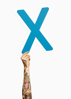 Hand holding the letter x
