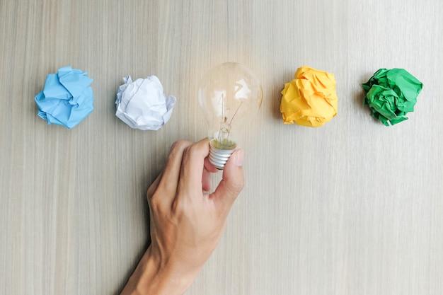 Hand holding light bulb or lamp