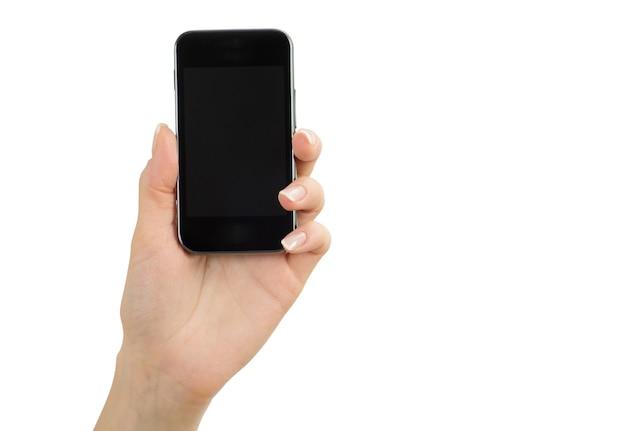 白で隔離の携帯電話を持っている手