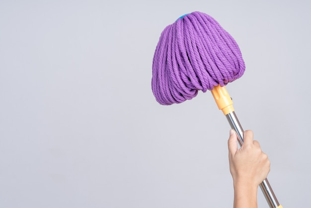 Hand holding modern floor mop with twist drying function
