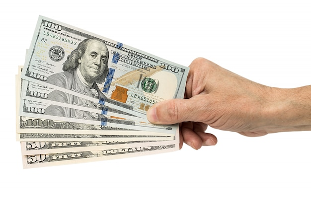 Hand holding money dollars, isolated on white