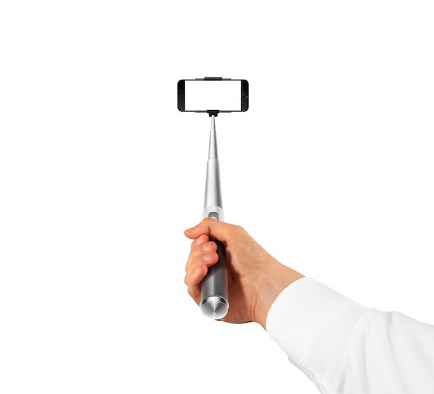 Hand holding monopod with blank screen phone mock up