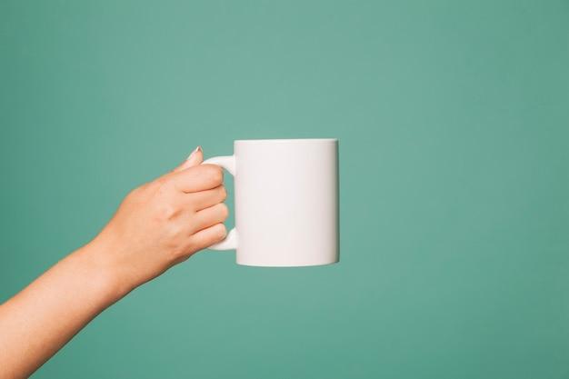 Hand holding a mug