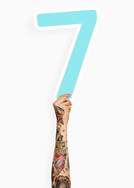 Hand holding number seven sign
