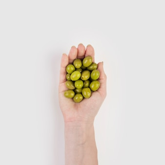 Hand holding organic olives