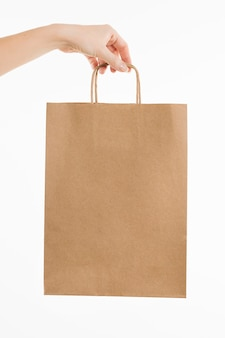 Hand holding paper bag
