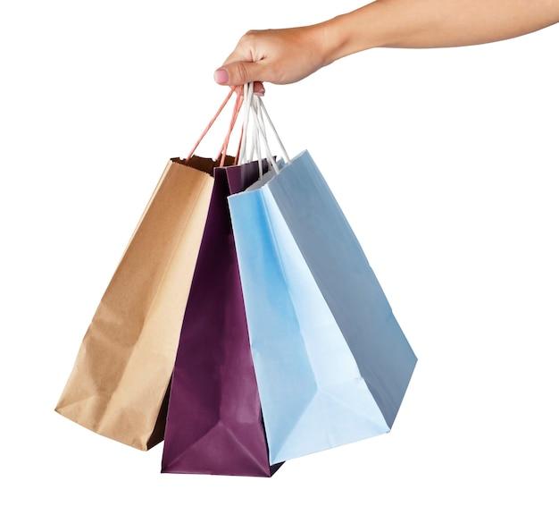 흰색 배경에 고립 된 종이 쇼핑백을 들고 손