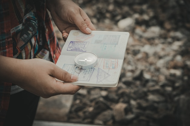 Hand holding a passport of the compass to find travel destinations. vintage style.