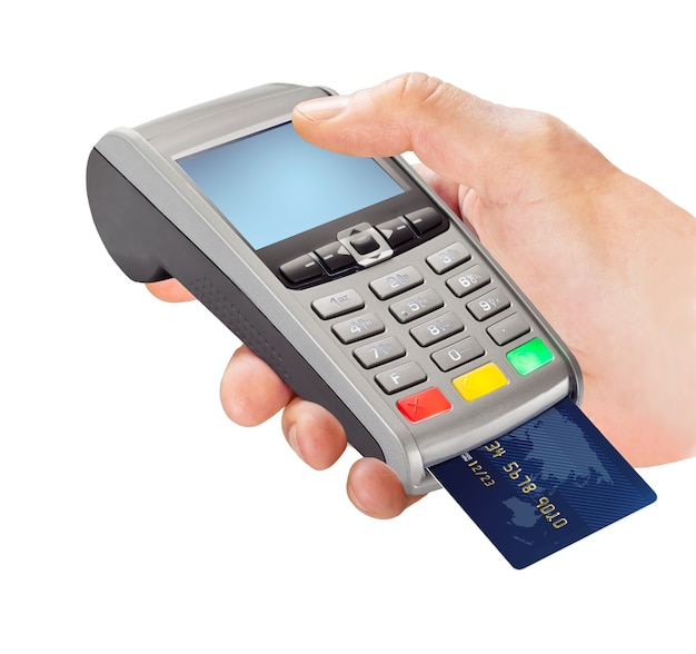 Hand holding payment terminal with card isolated on white background