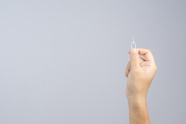 Hand holding phone sim card pin
