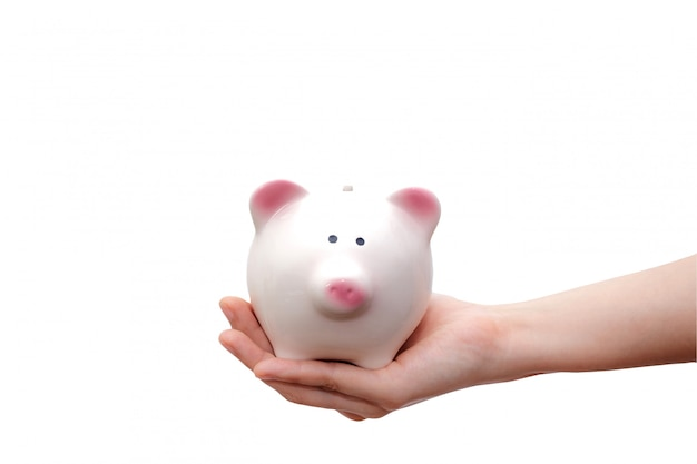 Hand holding piggy bank isolated on white background.