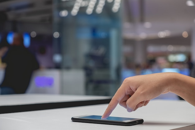 Hand holding and pointing mobile smart phone