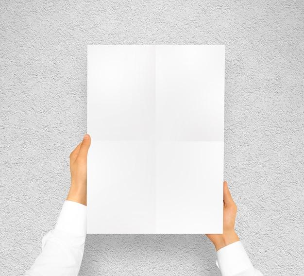 Hand holding poster mock up design mockup