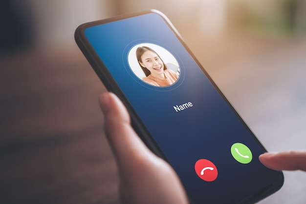 Hand holding smartphone and show incoming call  screen from young girl