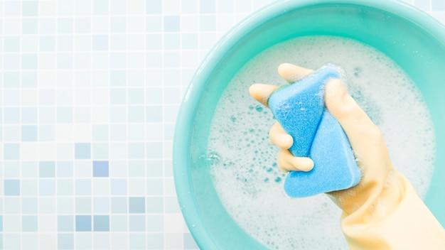 Hand holding sponge