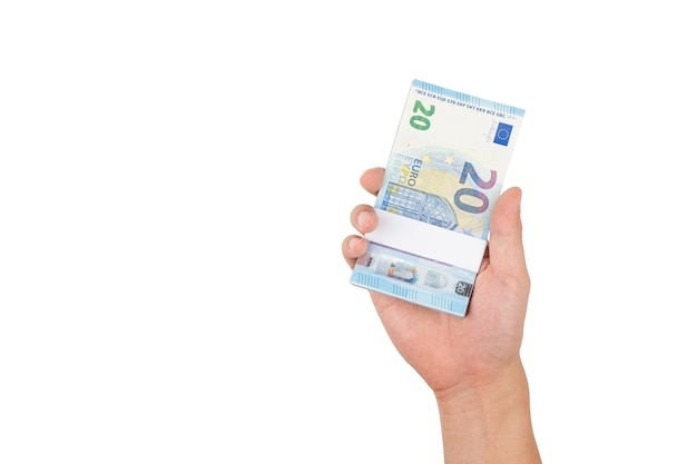 Hand holding stack of twenty euro bills isolated on white background with clipping path.