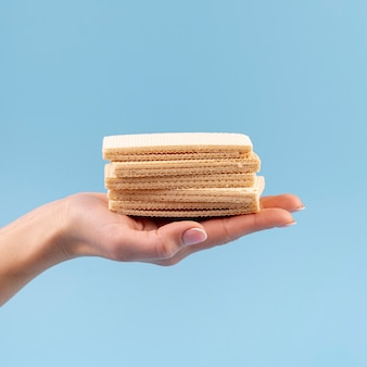 Hand holding stacked wafers with copy space