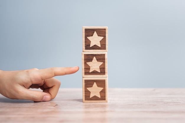 Hand holding star block