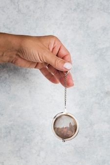 Hand holding tea strainer