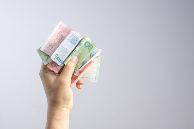 Hand holding thai money or banknotes